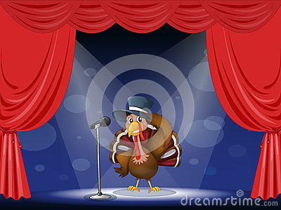 A turkey with a hat at the center of the stage