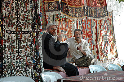 Turkish carpet vendors selling their carpets Editorial Image