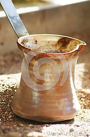 Turkish coffee pot on the sand
