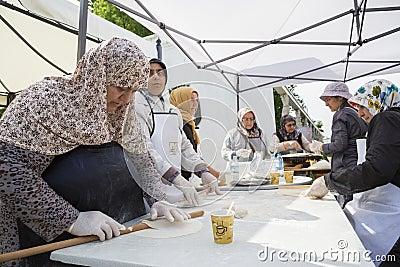 Turkish women preparing pies Editorial Stock Image