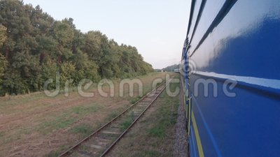 Turn of the train. UKRAINE, BERDYANSK - Jule 19, 2019: View from the car on the turn of the train and a smoking locomotive of Berdyansk in Jule 2019 in Ukraine stock video