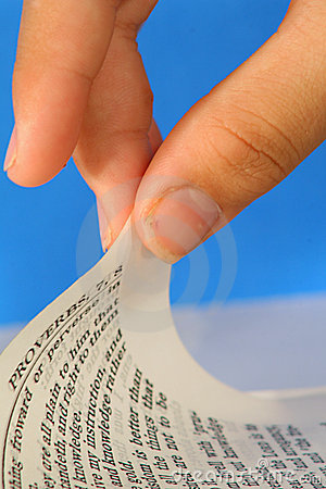 Turning the page of a bible - Proverbs