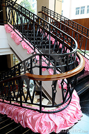 The turning staircase with iron railings