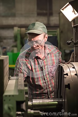 Free Turning Works. The Turner Makes A Metal Part On A Mechanical Lathe. Royalty Free Stock Image - 108216616