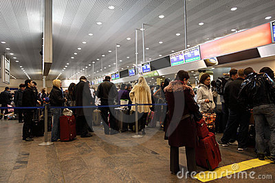 Turns to the registration desk at the airport Editorial Stock Photo