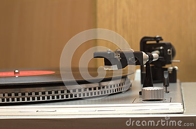 Turntable with vinyl record closeup