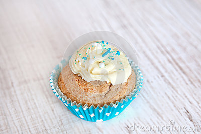 Turquoise cupcake with butter frosting