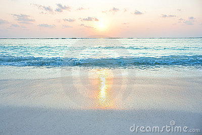 Turquoise ocean in sunrise at tropical island