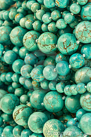 Turquoise round beads background