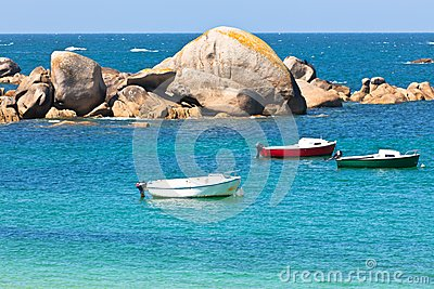 Turquoise sea and fisherman boats