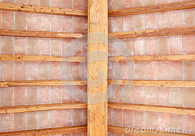 Tuscan wood beam ceiling red bricks pattern. Italy