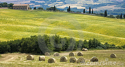 Tuscany countryside with farm and hayball