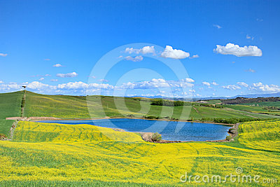 Tuscany, landscape, Italy. Small lake and fields