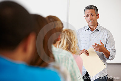 Tutor teaching class of students