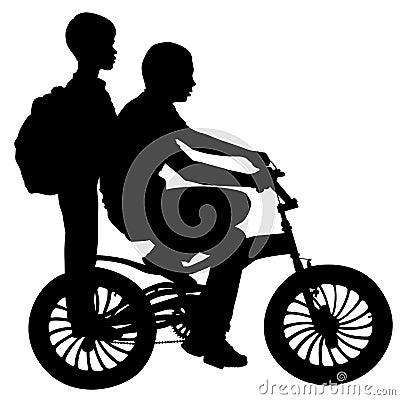Två pojkar på en cykel