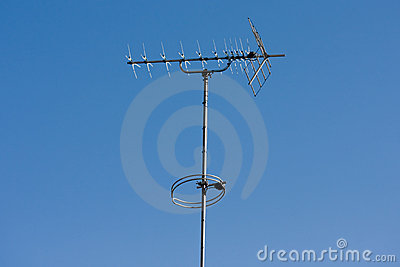 TV aerial with blue sky background