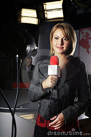 Tv news reporter and video camera Editorial Photo