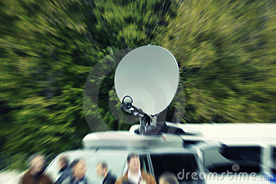 Tv news truck in intentional motion blur