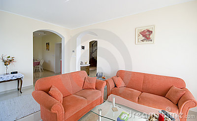 TV room with orange sofas