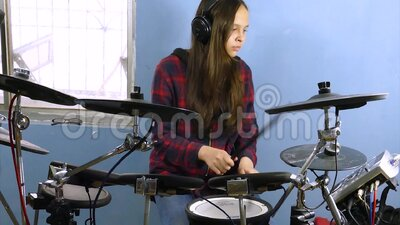 Tween girl playing electronic drums stock footage