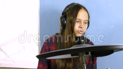 Tween girl playing electronic drums stock video