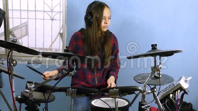 Tween girl playing electronic drums stock video footage