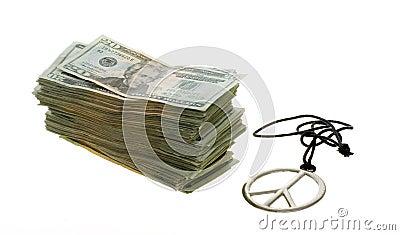 Twenty Dollar Bills next to Peace Sign Necklace
