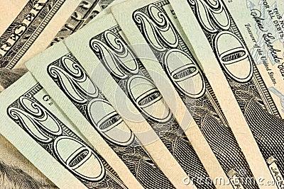 Twenty dollars bills stacked