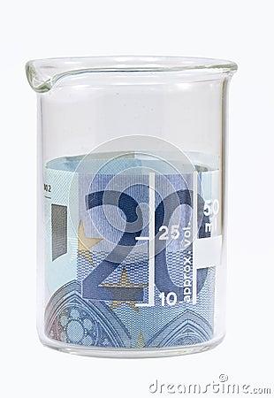 Twenty euro banknote in white beaker