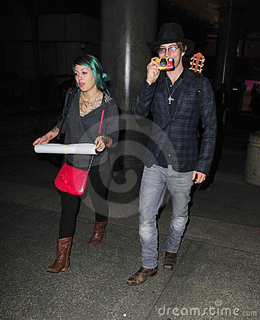 Twilight actor Jackson Rathbone and girlfriend LAX Editorial Stock Image