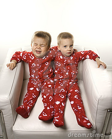 Free Twin Boys Sitting Together. Stock Image - 2037951
