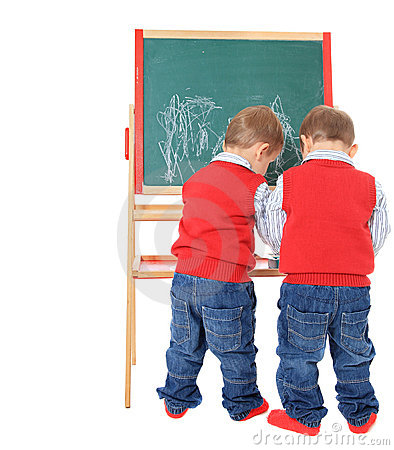 Twin brothers playing with chalkboard