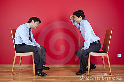 Twin businessman fighting
