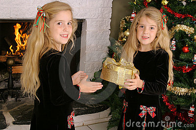 Twin children opening presents