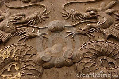 Twin dragons in stone relief