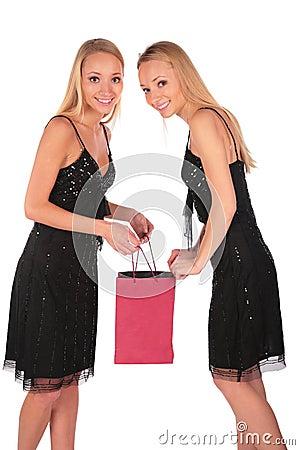 Twin girls looks in to bag 2