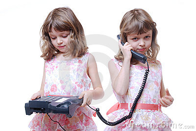 Twin girls with phone