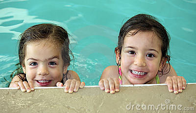 Twin girls swimming