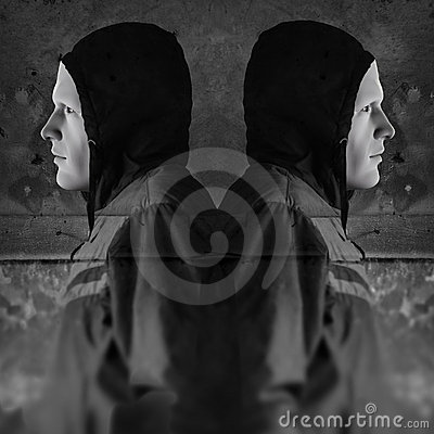 Twin hooded figures