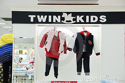 Twin kids   baby clothes shop Editorial Photo