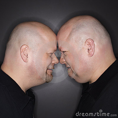 Free Twin Men Facing Off. Stock Photo - 2425260
