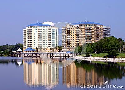 Twin resort buildings reflected in lake