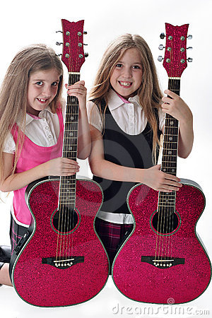 Twin sisters with guitars