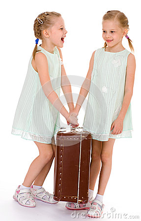 Free Twin Sisters With A Big Old Suitcase. Stock Images - 39560894