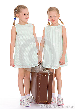 Free Twin Sisters With A Big Old Suitcase. Royalty Free Stock Photos - 39560898