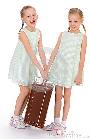 Free Twin Sisters With A Big Old Suitcase. Stock Photos - 39560933