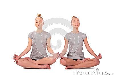 Twin sport girls meditating