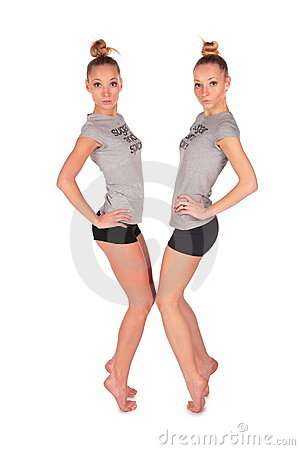 Twin sport girls stands on tiptoe