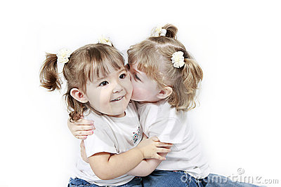 Twin toddlers kissing