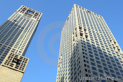 Twin towers against blue sky